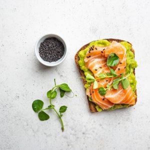 Toast,With,Avocado,Cream,And,Smoked,Salmon,Over,White,Background,