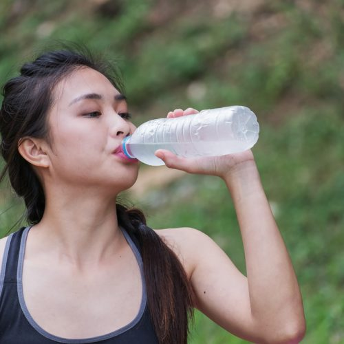 Beautiful,Young,Woman,Drinking,Water,After,Training