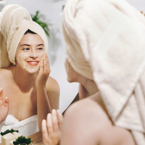 Skin,Care,Concept.,Young,Happy,Woman,In,Towel,Making,Facial