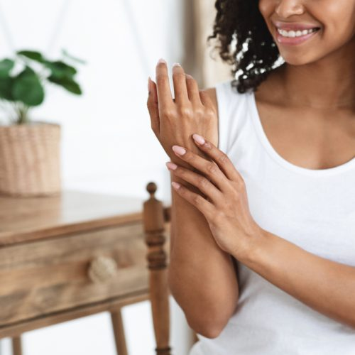Anti-aging,Hand,Care.,Smiling,African,Woman,Touching,Her,Soft,Body